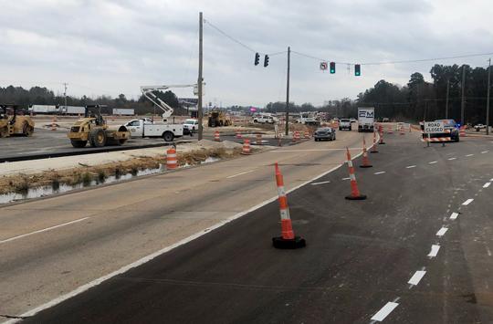Traffic is diverted safely during highway paving work - Superior Asphalt