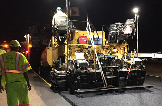 Superior Asphalt Employees performing night work in PPE and well-lit environment